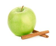 Ripe green apple with cinnamon sticks Stock Images