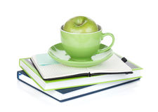 Ripe green apple, coffee cup and office supplies Stock Photos
