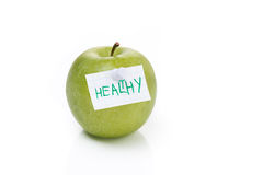 Ripe green apple and label with the word healthy, isolated Stock Image