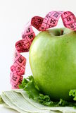 Ripe green apple with measuring tape Stock Photography