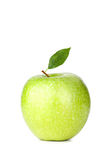 A Ripe Green Apple with water drops Stock Images