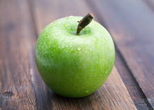 Ripe green apple on the wooden. Royalty Free Stock Photography
