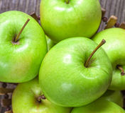 Ripe green apples and apple slices. On wooden gray background Royalty Free Stock Photo