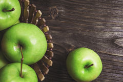 Ripe green apples and apple slices. On wooden gray background stock images