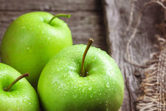 Ripe green apples and apple slices. On wooden gray background Stock Photo