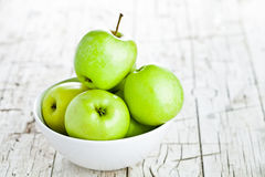 Ripe green apples in bowl Royalty Free Stock Image