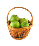 Ripe green apples in brown wicker basket isolated Royalty Free Stock Photo