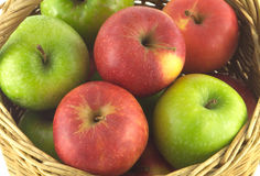 Ripe green apples in brown wicker basket  Royalty Free Stock Image