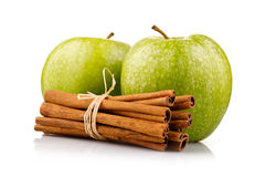 Ripe green apples with cinnamon sticks isolated Royalty Free Stock Photos