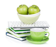 Ripe green apples, coffee cup and office supplies Royalty Free Stock Photo