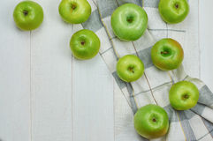 Ripe green apples. On light wooden background. Nature fruit concept. Top view. Close-up. Selective focus Stock Images