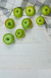 Ripe green apples on light wooden background. Nature fruit concept. Top view. Close-up. Selective focus Royalty Free Stock Image