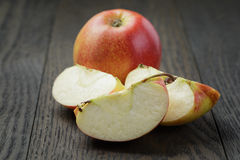 Ripe green apples sliced on wood table Royalty Free Stock Image