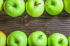 Ripe green apples. On wooden background Stock Photos