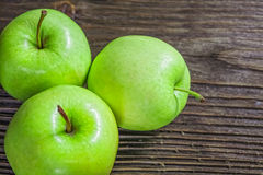 Ripe green apples. On wooden background Stock Images