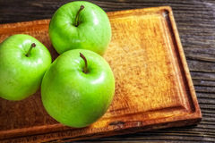 Ripe green apples on wooden. Background royalty free stock photography