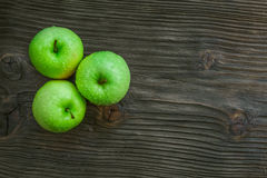 Ripe green apples on wooden. Background Stock Images