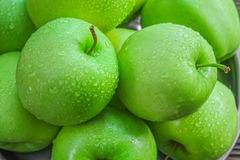 Ripe green apples. On wooden background Stock Photo