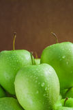 Ripe green apples. On wooden background Royalty Free Stock Photography