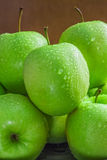 Ripe green apples. On wooden background stock photography