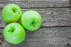 Ripe green apples. On wooden background Royalty Free Stock Image