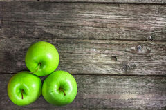 Ripe green apples. On wooden background Royalty Free Stock Photo