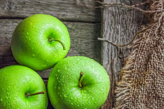 Ripe green apples. On wooden background Royalty Free Stock Photos