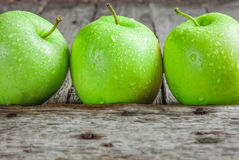 Ripe green apples. On wooden background Royalty Free Stock Images