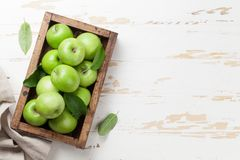 Green apples in wooden box. Ripe green apples in wooden box. Top view with space for your text Stock Photo