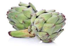 Ripe green artichoke vegetables isolated Stock Photos