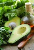 Ripe green avocado cut in half Stock Photo
