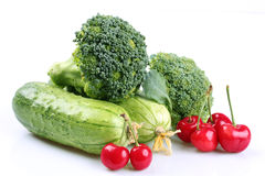 Ripe green cauliflower and cucumbers and cherry Royalty Free Stock Photos