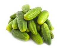 Ripe green cucumbers. Hill lay on white background Stock Images