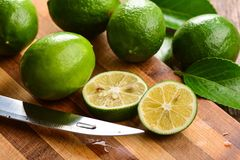 Ripe green cut limes Royalty Free Stock Photos