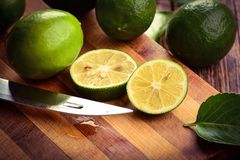Ripe green cut limes Royalty Free Stock Images