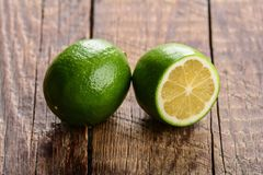 Ripe green cut limes Stock Photography