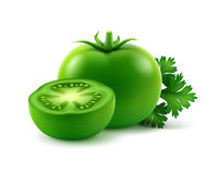 Ripe Green Fresh Cut Whole Tomatoes with parsley Stock Photos