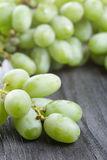 Ripe green grapes on black wood table Stock Photo