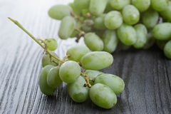 Ripe green grapes on black wood table Royalty Free Stock Photo