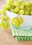 Ripe green grapes in a bowl. On green checkered napkin Royalty Free Stock Image