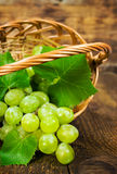 Ripe green grapes in a wicker basket Stock Photo