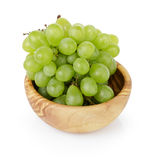 Ripe green grapes in wood bowl Royalty Free Stock Images