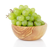 Ripe green grapes in wood bowl Stock Image