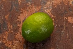 Ripe green lime. Over the wooden background stock photo