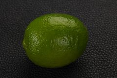 Ripe green lime. Over the wooden background stock image