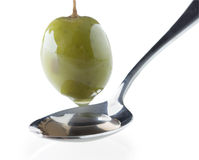 Ripe green olive on a spoon Stock Images