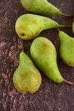 Ripe green pear fruit. On wooden background Royalty Free Stock Photography