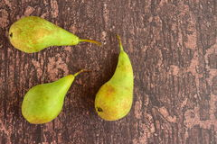 Ripe green pear fruit. On wooden background Royalty Free Stock Image