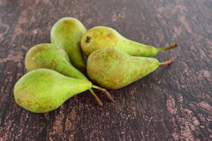 Ripe green pear fruit. On wooden background Stock Photography
