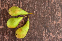 Ripe green pear fruit. On wooden background Royalty Free Stock Images